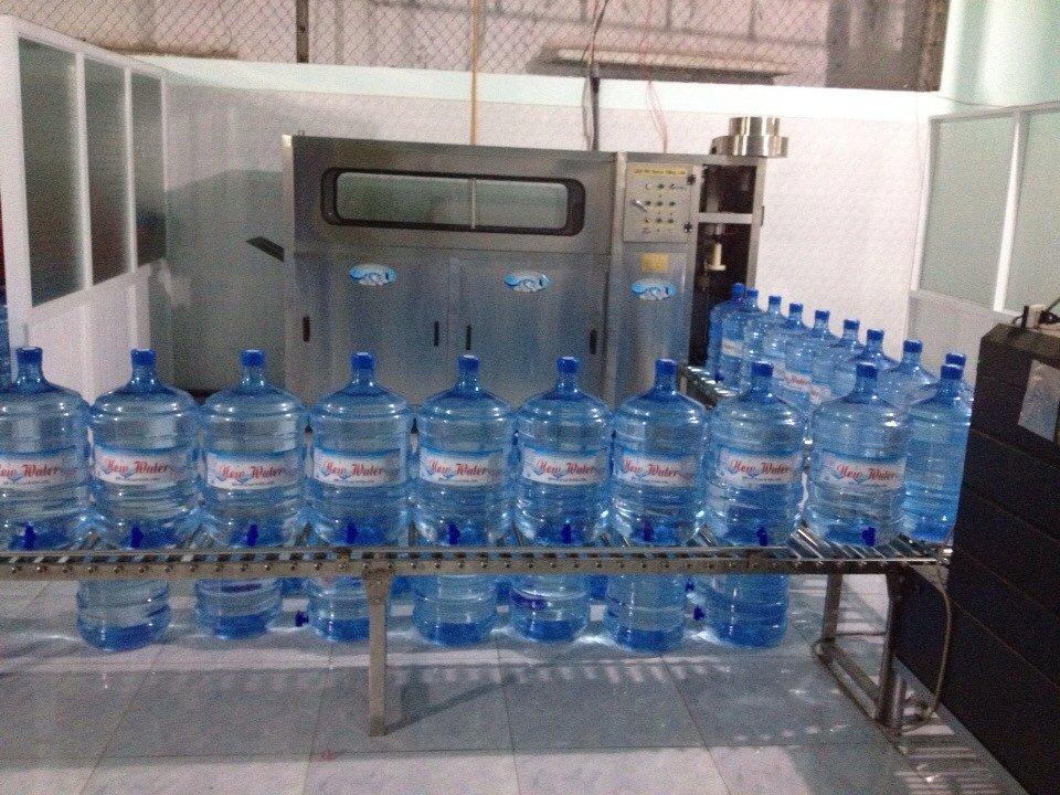 dây chuyền sản xuất nước uống đóng bình tự động